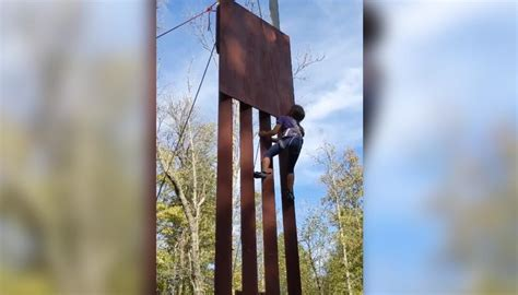Eight-year-old girl climbs replica of Donald Trump's